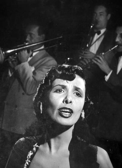 "Singer Lena Horne singing ""I Feel So Smoochie"" w. the band at the Copocabana nightclub."