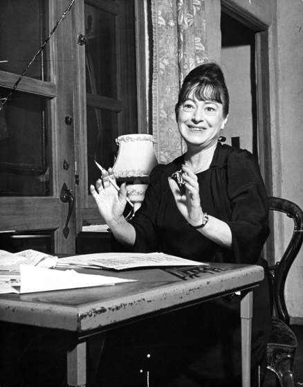 Poet/writer Dorothy Parker w. manuscripts in front of her as she sits at work table at home. (Photo by Bob Landry/The LIFE Images Collection/Getty Images)