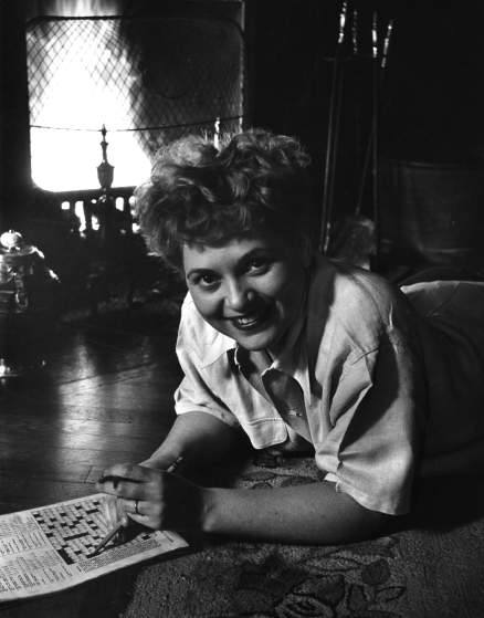 Judy Holliday in her apartment on Waverly Place in New York City